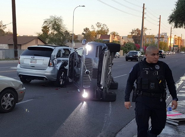 Uber suspends self-driving car program after Arizona car accident
